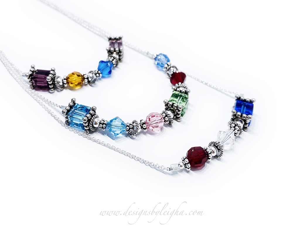 This is a sterling silver & Swarovski crystal 3 Generation Birthstone Necklace. It has a combination of 6mm Square, 6mm Round and 6mm Bicone Swarovski Crystals in the 12 popular birthstone colors. Thirteen grandchildren's birthstones are shown in the example