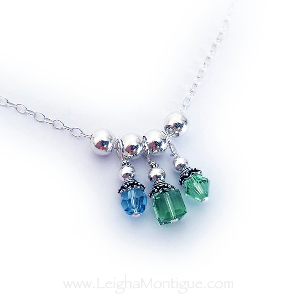 This birthstone charm necklace is shown with 3 Swarovski Birthstone Crystal Charms and 4 - .925 sterling silver spacer beads. A Round March or Aquarmarine Birthstone Crystal, a Square Peridot or August Birthstone Crystal and a Bicone Peridot or August Birthstone Crystal.