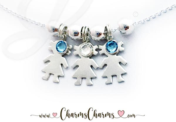 This necklace has 3 kid charms: 3 Girl Charms their birthstones. They are in birth order: Girl/March Girl/April Girl/March.
