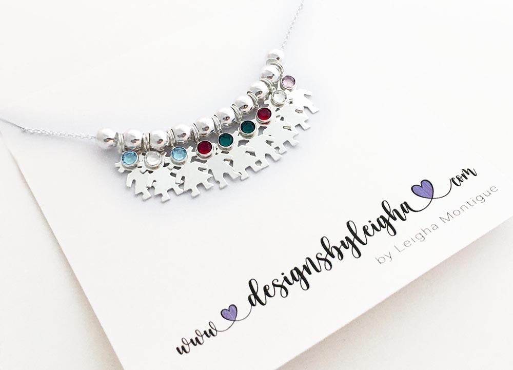 This necklace has 9 kid charms: 6 Girl Charms & 3 Boy Charms and all of their birthstones. They are in birth order: Girl/March Girl/April Girl/March Boy/January Girl/May Boy/May Girl/January Girl/April Boy/June