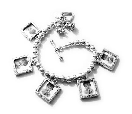 Picture frame charm bracelet. Here is a picture frame charm bracelet - click for more information.
