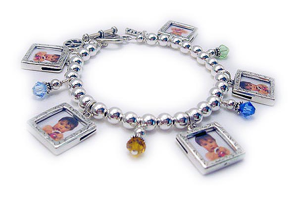 This Design your own Charm Bracelet is shown with 11 charms and a heavy heart toggle clasp. Charms shown; Angel with wings, Mom filigree, Heart Picture Frame, Fancy Cross, Heart in a Heart, Prayer Box, Peace Dove, Love Filigree, Heart Picture Frame, Simple Cross and Jesus Fish.