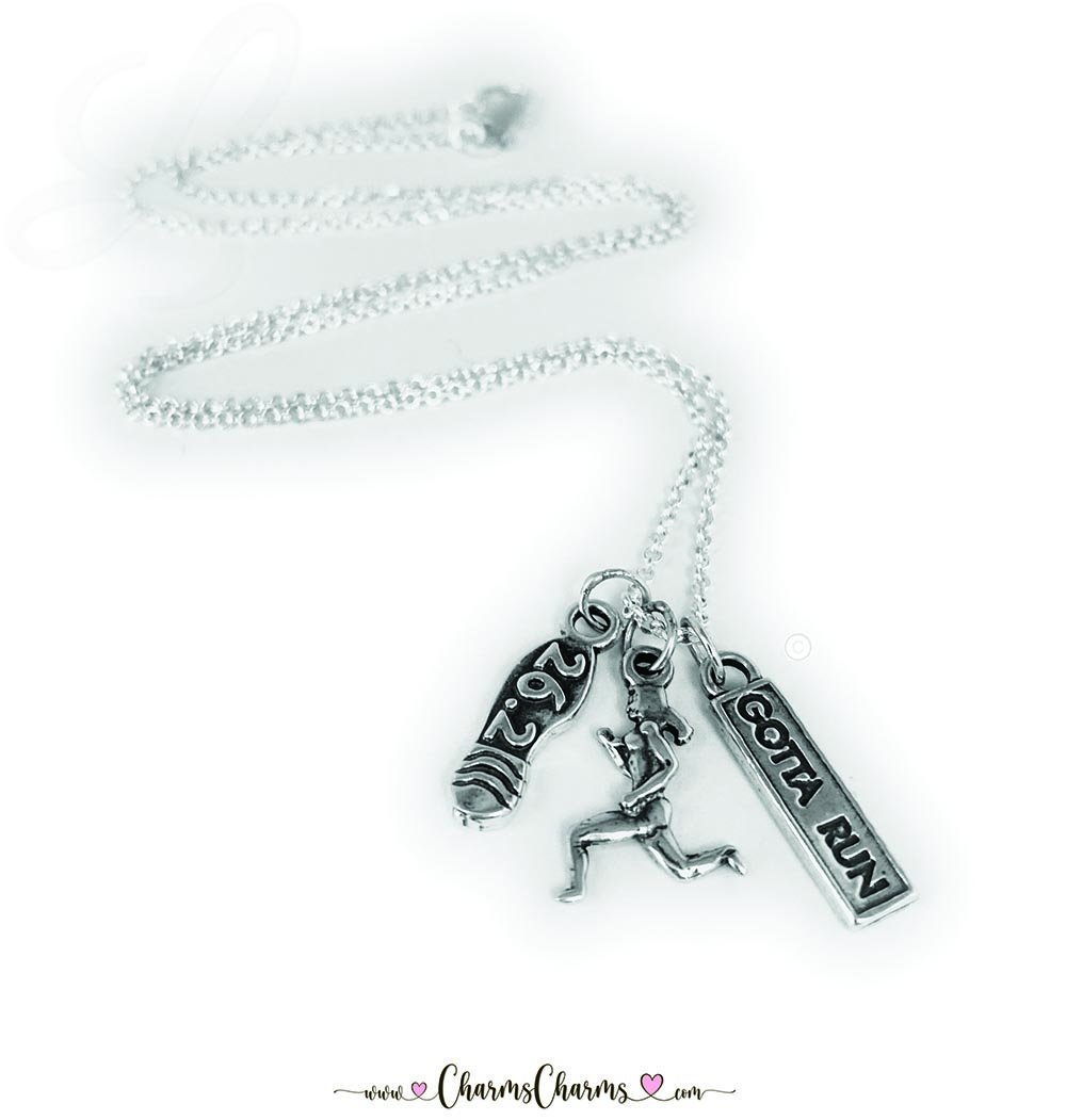 There are 3 charms shown on this ROLO Chain; 26.2, Woman Runner and GOTTA Run sterling silver charms.