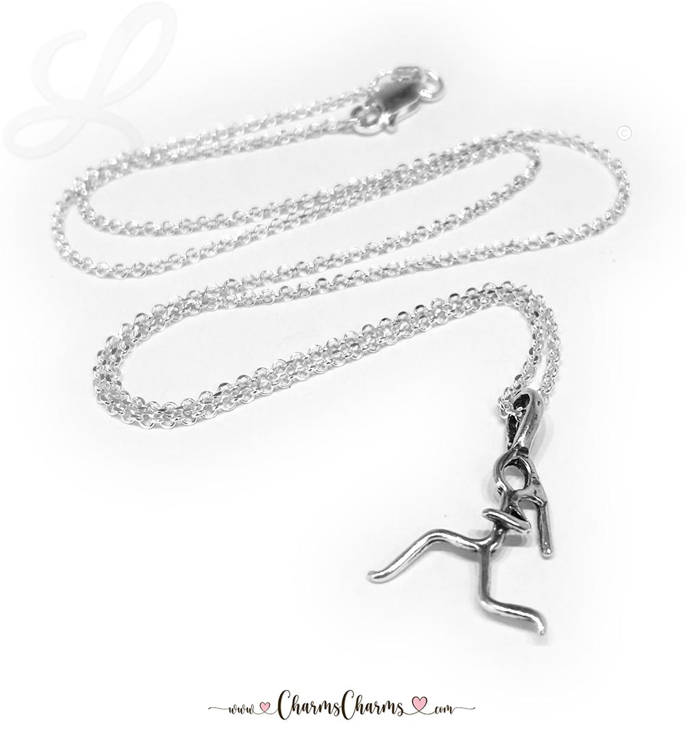"This Runner Charm necklace has 1 sterling silver charm ""Stick Runner"" and is on an 16"" Rolo Chain sterling silver necklace."