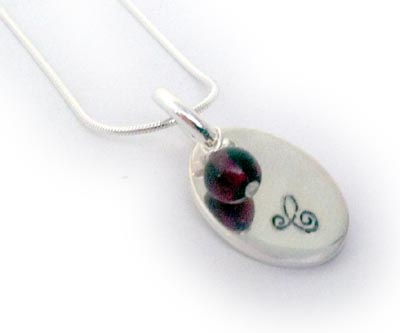 Hand Stamped Necklace with the Initial C and a Garnet Gemstone for January (sterling silver)