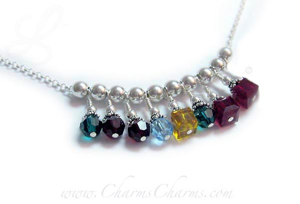 This Mothers Charm Necklace has 8 birthmonths represented; May/Round (Emerald), February/Round (Amethyst), January/Round (Garnet), March/Round (Aquamarine), November/Square (Golden Topaz), May/Round (Emerald), July/Square (Ruby) and another July/Square (Ruby). On a sterling silver chain with a lobster claw clasp.